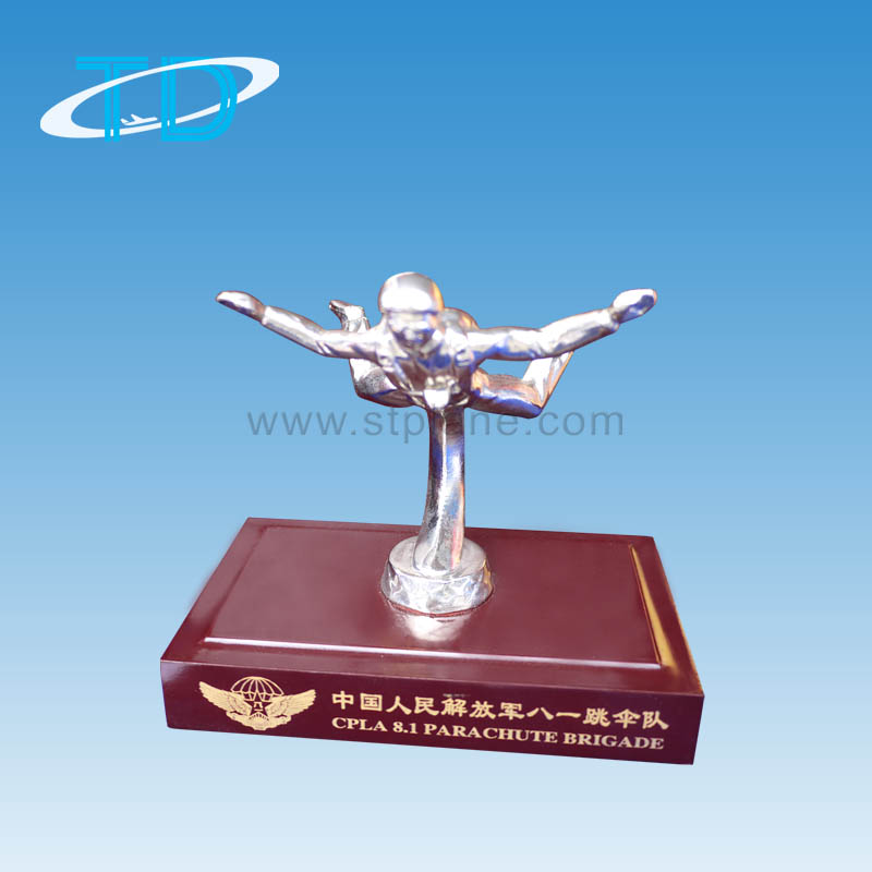 Metal silver flying statuette